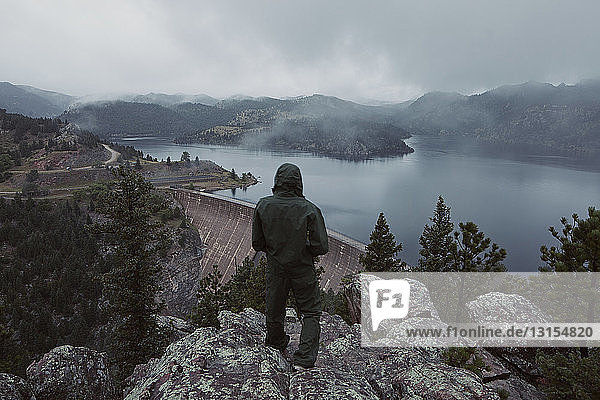 Man overlooking the Gross Dam in Colorado  USA