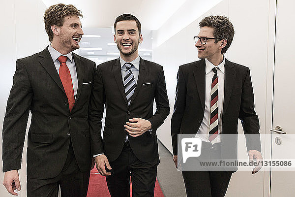 Businessmen walking through corridor