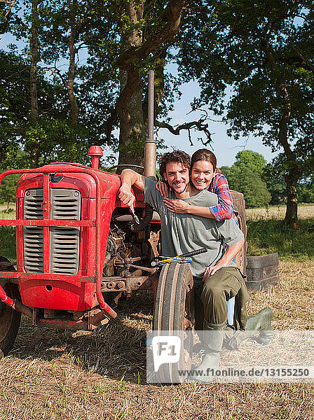 couple embraced by tractor