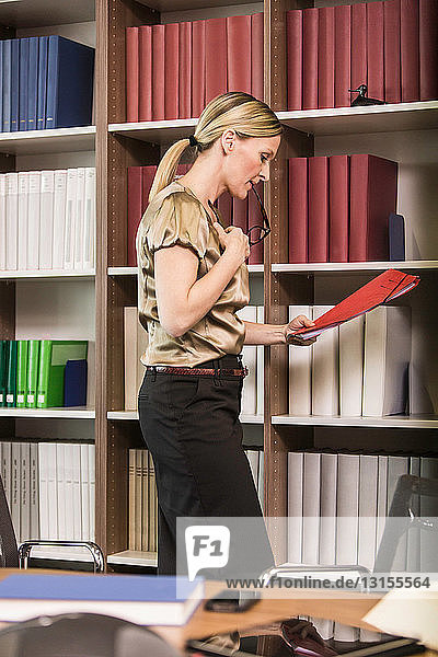 Female lawyer holding file