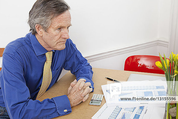 Businessman with papers at desk