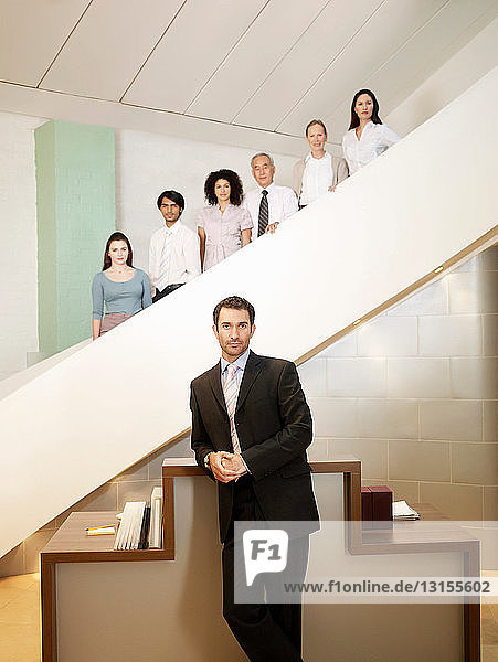 Portrait of office workers on stairs