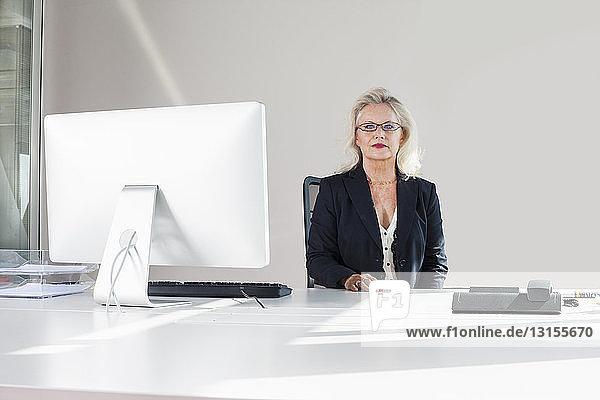 Businesswoman at desk,  portrait