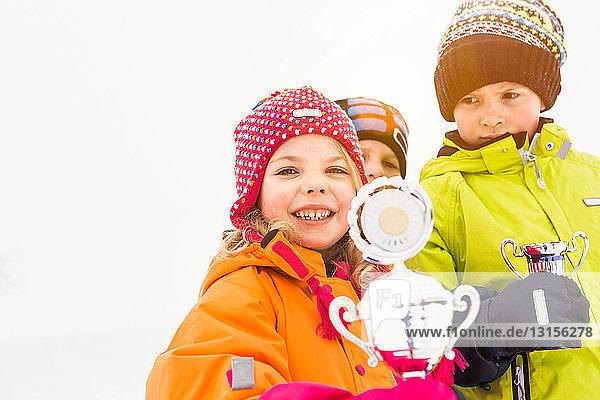 Portrait of children holding trophies