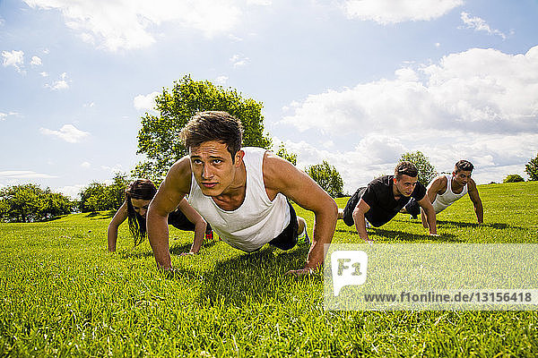 Personal trainers doing outdoor training in urban place  Munich  Bavaria  Germany