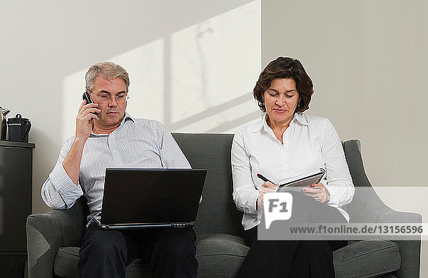 Mature couple working together