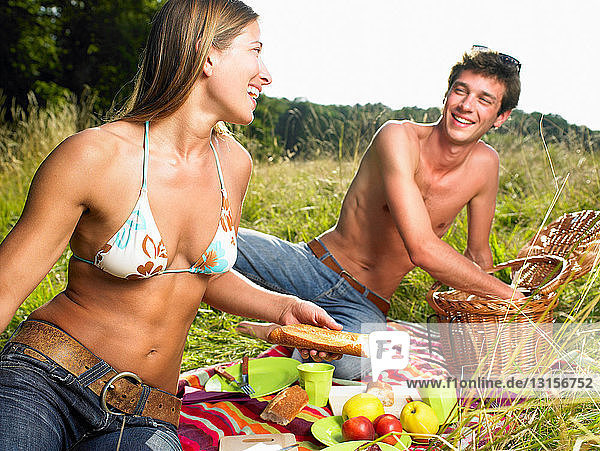 Couple having a picnic in a field