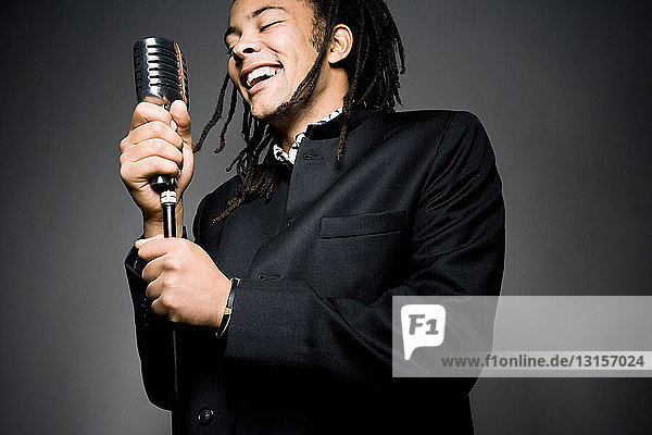 man smiling with mic