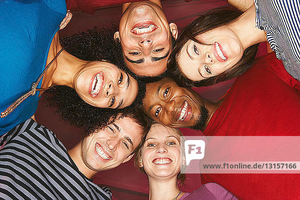 Young group of friends  heads together Young group of friends, heads together