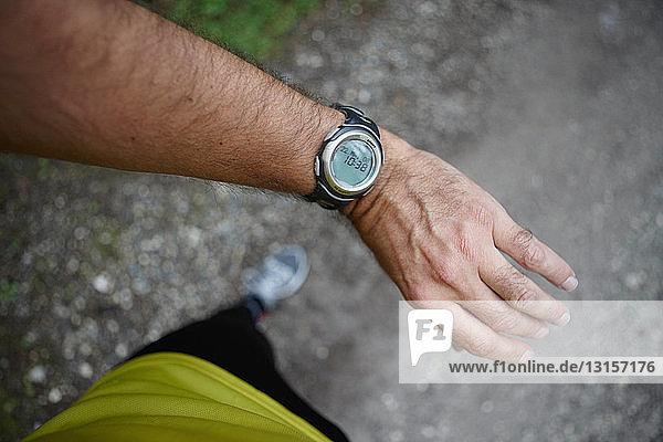 Runner checking his watch Runner checking his watch