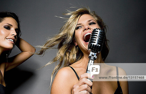 woman singing into mic