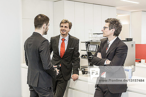 Businesspeople standing in cafeteria