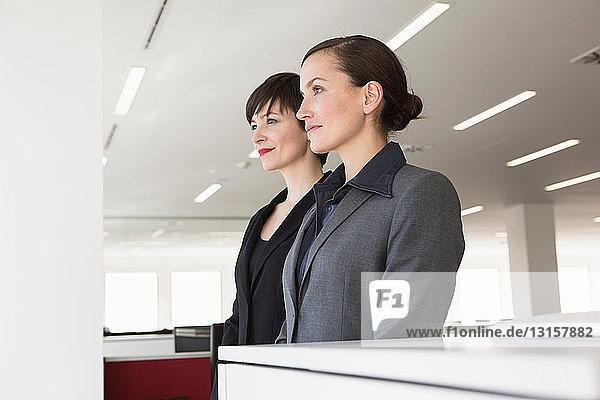 Two businesswomen side by side