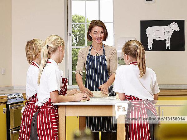 Children cook with a teacher