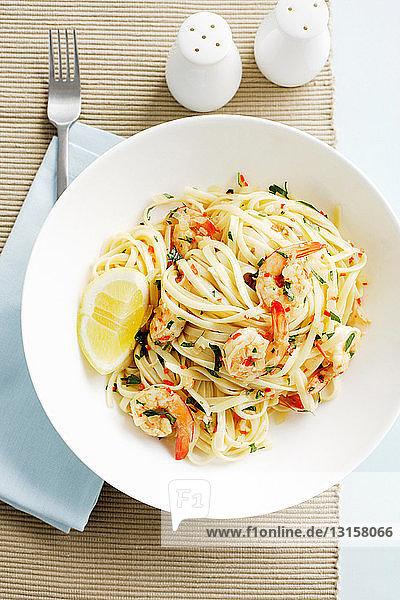 Bowl of linguine pasta with prawns