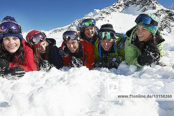 Friends lying on snow  Kuhtai  Austria