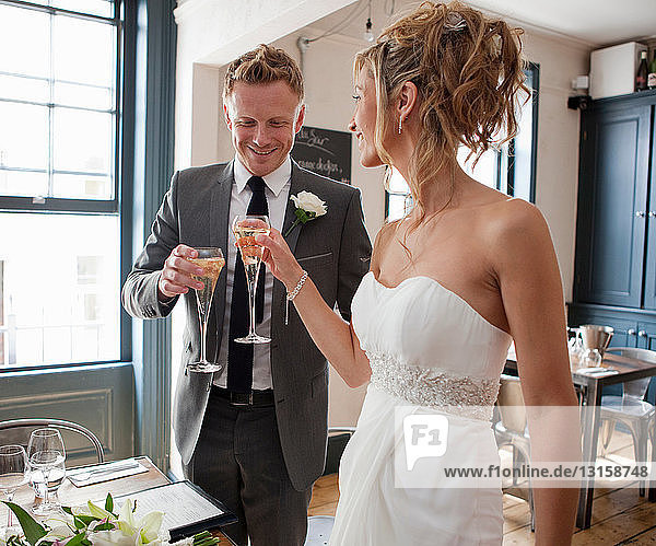 Bride and groom toasting with champagne at wedding ceremony