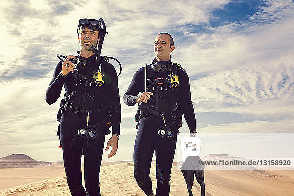 Two men in wetsuits  Great Sand Sea  Sahara Desert  Egypt  Africa