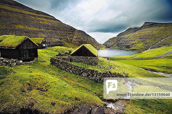 Stone houses on grassy mountainside