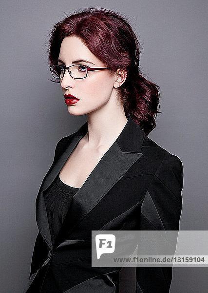 Woman in eyeglasses and blazer