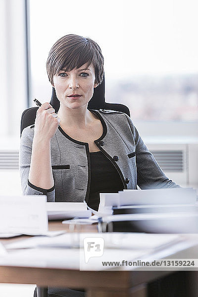Portrait of businesswoman sitting at desk