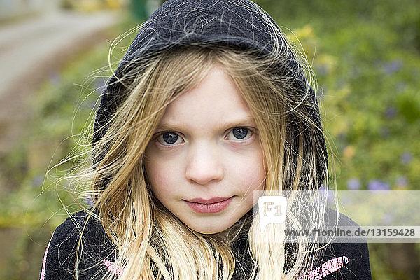 Portrait of girl wearing hood