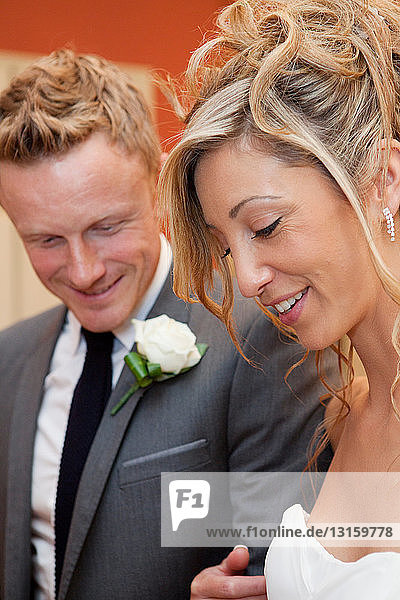 Bride and groom smiling at wedding ceremony