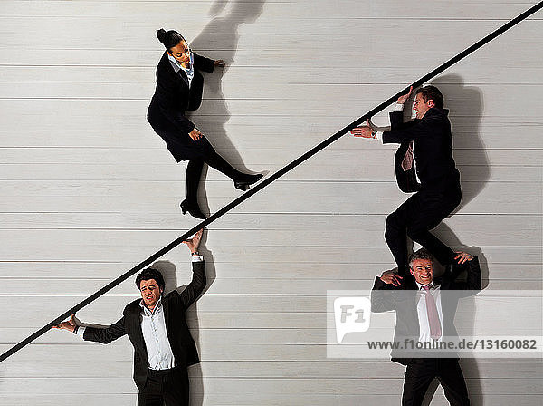 Business men supporting woman