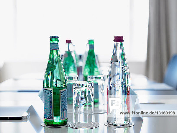 Bottles of water in a conference room