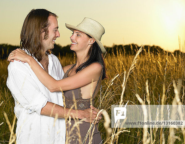 Couple at sunset  in a field Couple at sunset, in a field