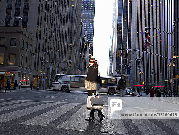Elegant woman crossing New York street