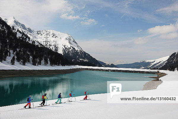 Skiers by lake and mountain  Kuhtai  Austria