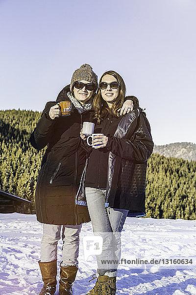 Friends enjoying coffee on snow-covered Achenkirch  Tirol  Austria