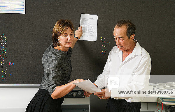 Colleagues looking at notes