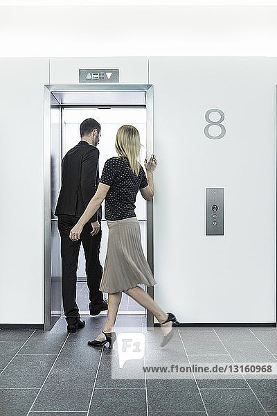 Businesspeople going into elevator