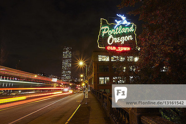 Highway and neon sign at night  Portland  Oregon  USA