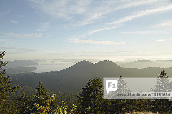 Hazy view of Mount Constitution and lake  Orcas Island  Washington State  USA