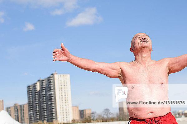 'Senior male participant in ''polar bear'' winter swim  Coney Island  New York  USA'