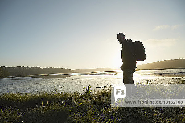 Portrait of silhouetted male hiker at dusk  Puget Sound  Washington State  USA