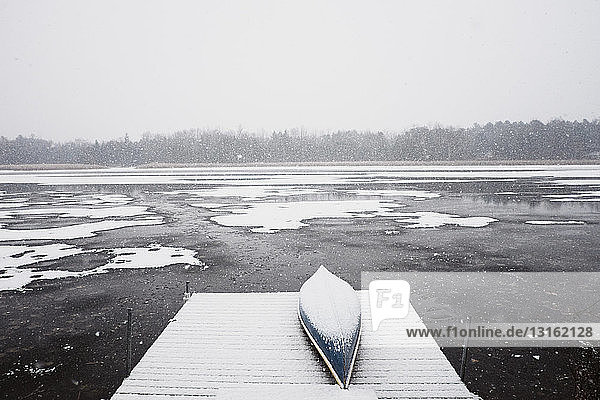 Snow covered pier and lake  Omemee Ontario Canada