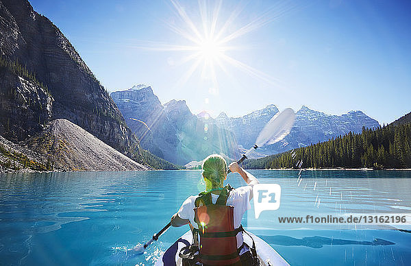 Mid adult woman kayaking  Moraine Lake  Alberta  Canada