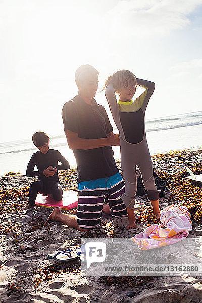 Father and children preparing to surf  Encinitas  California  USA
