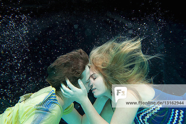Young couple kissing underwater