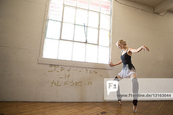 Ballet dancer on tip toes in studio