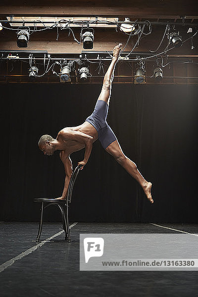 Dancer balancing on chair