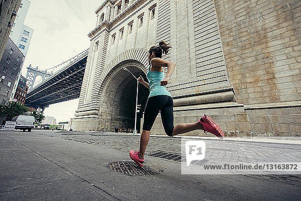Young female runner running in Brooklyn  New York  USA