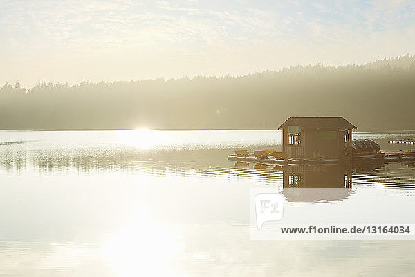 Boathouse on misty lake at sunrise  Orcas Island  Washington State  USA