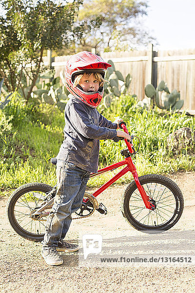 Boy with a bicycle  wearing helmet