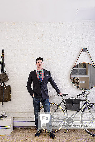 Young man in hallway with bicycle
