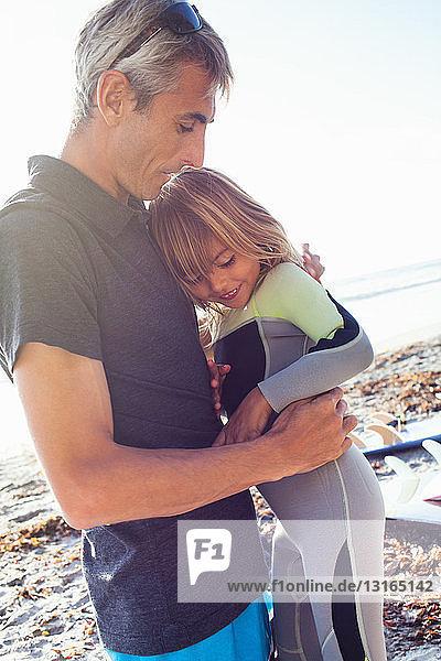 Father and daughter on beach  Encinitas  California  USA